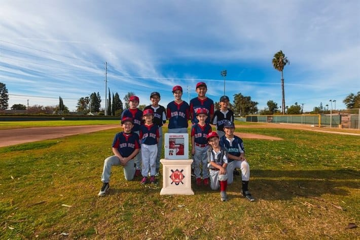LoanMart Supports Community Little League Team with Donation of Life Saving Medical Device