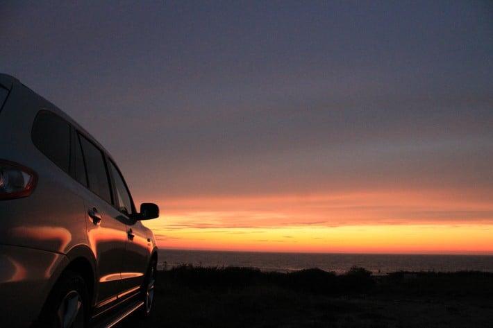 car sunset road path journey