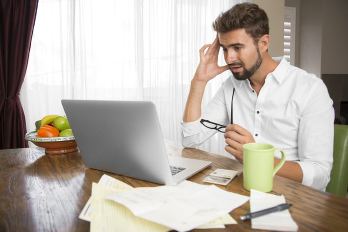 stressed man on laptop