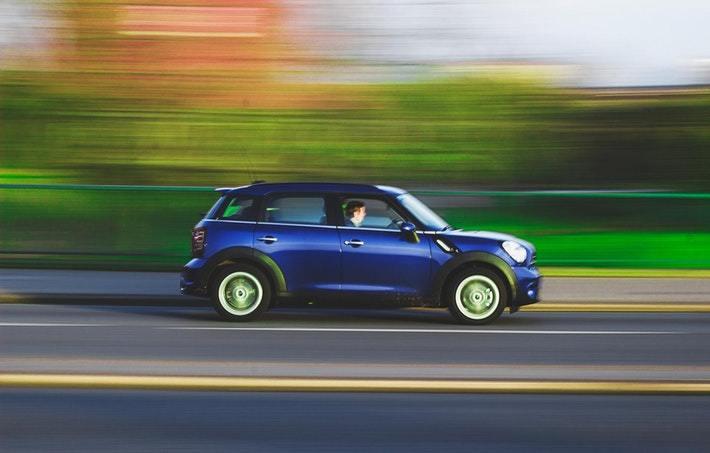 driving a blue car