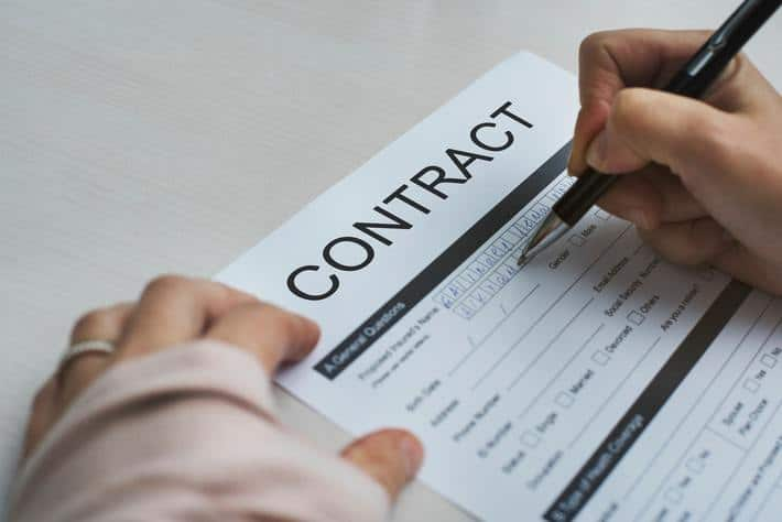 filling out a contract