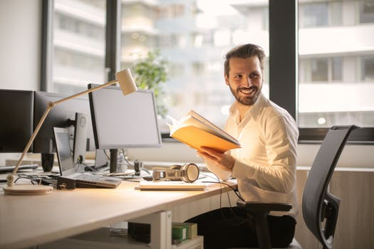 smiling man doing office work