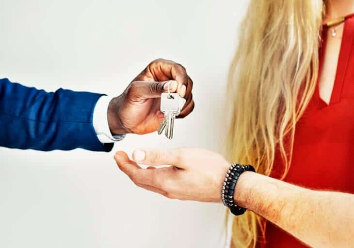 giving keys to a man