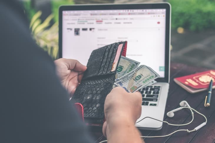 wallet with money and laptop