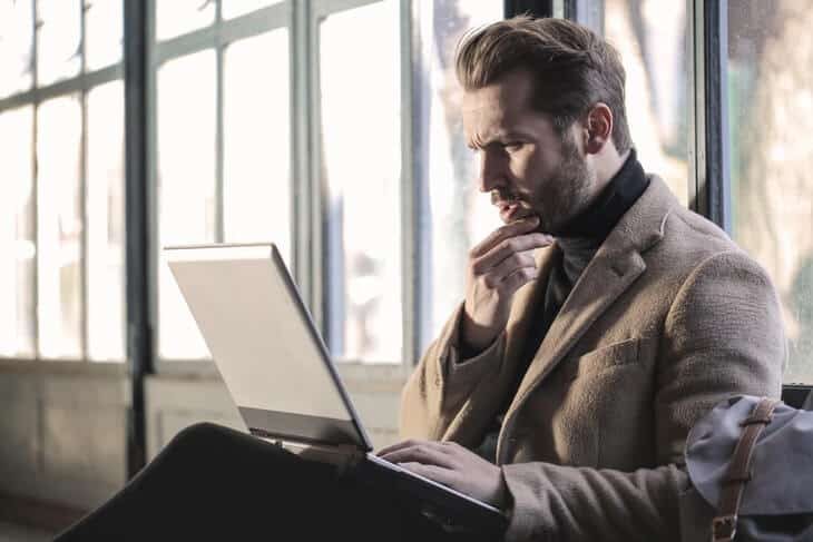 frustrated looking man on laptop