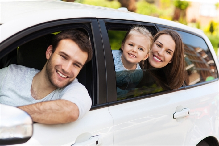 Family of 3 in a white car