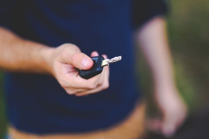 man holding car key