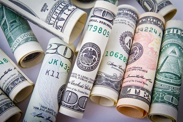 rolls of money from title loan
