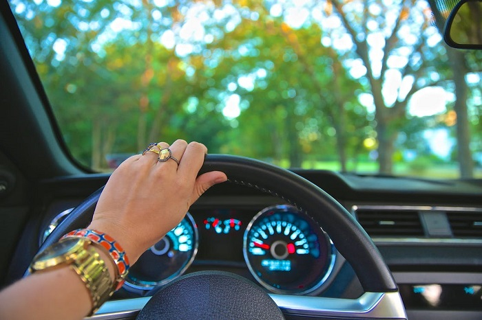 Woman's hand on a steering wheel